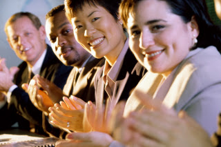 Portrait of business executives clapping