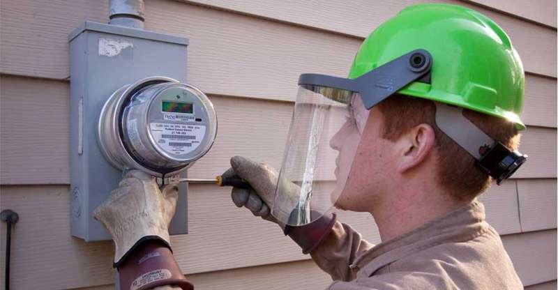 Electrical Engineer installing smart meter
